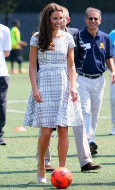 Kate Middleton showed off her sporty side at Bacon's College in East London, where she slipped on a breezy printed Hobbs dress, a white belt, and wedges to play ping pong and soccer before hitting the karate mat.
