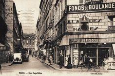 """La rue Coquillière au coin avec la rue Coq-Héron et le restaurant """"A la Cloche des Halles"""", vers 1925."""