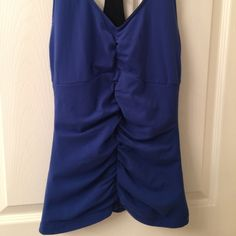Lucy Blue Rushed Core Control Yoga Top. Gently worn. Fabulous design with spandex liner to hold core. Lucy Tops Tank Tops