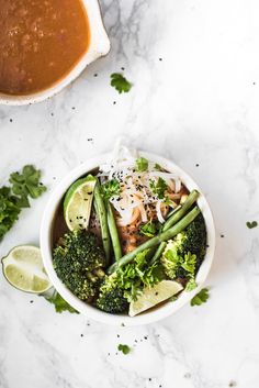 Vegan Bliss Bowl with Rice Noodles, Veggie Stock, Beans, Broccoli, Lime and Cilantro.
