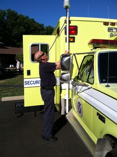 EMA's Bob setting up weather station at Genoa Twp's  National Night Out.