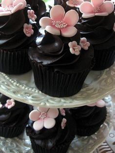 - Dark chocolate cupcake with pink marzipan flowers