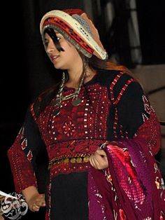 Al Bireh thob. Each region in Palestine had a distinct style of traditional dress, called a thob. (rhymes with robe, not knob!) This image is from an album here https://www.facebook.com/media/set/?set=a.117417781675536.28969.117391495011498=3