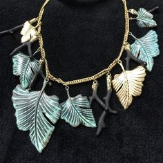 """16-20"""" LONG RACHEL ROY DESIGNER LEAVES NECKLACE Green oxidized leaves, black and  gold branches, and small gold leaves on a gold  tone chain. Signature wings and cz at lobster closure is designers logo. In excellent condition ❤️ Jewelry Necklaces"""
