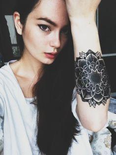 Girl with Large Mandala Tattoo On Arm