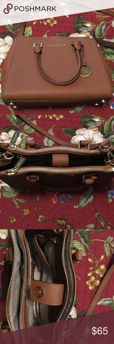 """Michael Kors Selma Medium Bag Excellent condition. No marks or dirt. The leather color is Luggage Brown. There are 2 zip top closures with 2 slip pockets and a zip pocket inside. Double rolled handles with a 4.5"""" drop. Adjustable strap with approximately 19.5 drop for cross body wear. Fully lined with gold toned hardware. Dimensions: approximately 11"""" (L) x 8"""" (H) x 4"""" (D). KORS Michael Kors Bags Satchels"""