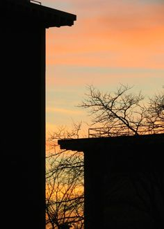 Silhouettes at sunset of Marquette University's Wehr Chemistry and Wehr Physics buildings.