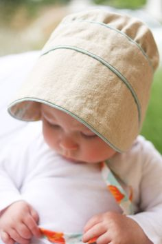 Peekaboo baby bonnet--reversible pattern, bc all our kids will wear bonnets… Sewing Projects For Kids, Sewing For Kids, Little Mermaid Costumes, Baby Hat Patterns, Baby Girl Crochet, Baby Bonnets, Baby Hats Knitting, Beanie Pattern, Heirloom Sewing