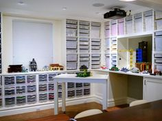 Basement Playroom Wall-to-Wall Lego Storage With Desk