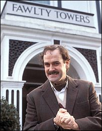 "Basil Fawlty, played by John Cleese. If you've never seen an episode of the British TV comedy ""Fawlty Towers"", your life is incomplete."