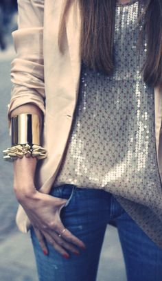 Dress up jeans with a metallic blouse, a blazer, and some serious accessories.