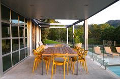 Mustard coloured Masters Chair's create a link to the yellow tones of the surrounding landscape