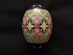 This is a Goose Egg done in a traditional geometric design, with Black, yellow and Reds. Pysanky or Ukrainian Eggs is an ancient folk art. All my