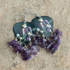 The Rolling Stones Mick Jagger guitar pick earrings with amethyst.
