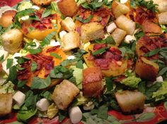 BLT salad with heirloom tomatoes and fresh mozzarella.  A cross between a BLT sandwhich and a caprese salad.  Homemade croutons and a lemony creamy garlic dressing make this a taste of summer in every bite!