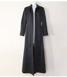 Simple. Clean. Bold Black Duster Coat up for grabs. The lightweight coat is fully lined w generous pockets on each side. The front has 4 buttons. Immaculate Condition.  This piece has a subtle dramatic classic look. Very Matrix like. Amazing on.  Label Size: 4 Pit to pit: 17.5 Shoulders: 15 Sleeves: 23.5 Waist: 30 Length: 56 slit from last button: 39 Slit in back: 24  Note: Mannequin is a Size 0-2 item not pinned.   Label: Anne Taylor / Made in Korea    When purchasing from BigSurGirrl B...