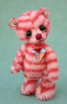 "Raspberry Ripple by Jane Mogford (Pipkins Bears) - 4"" (standing) created from extra long pile inspiration fabric with hand shading to eyes & ears, Needle sculpting to face & footpads weighted with steel shot, wearing a beautiful Swarovski crystal heart"