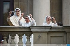 BRAZIL, Rio de Janeiro: Nuns cheer at a balcony of the San Joaquin Episcopal Palace in Rio de Janeiro, Brazil, before the arrival of Pope Francis, on July 26, 2013. Pope Francis will meet young convicts here and then return to Copacabana beach Friday where 1.5 million Catholics gathered on Rio de Janeiros seafront to see him speak the previous night in a massive ceremony for World Youth Day festivities. AFP PHOTO / GABRIEL BOUYS