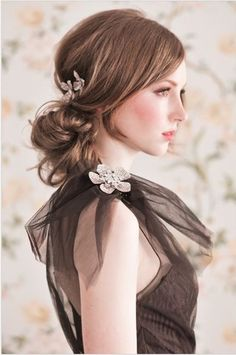 How gorgeous is this tousled updo with a flower piece? This is a great way to get the hair out of your face, but not feel like it's completely up.