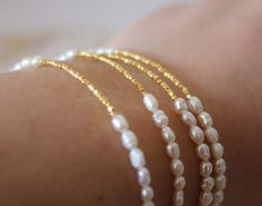 Pearl and gold Bracelet - Wedding Jewelry - Bridal Bracelet - Bridesmaid gift - Freshwater Pearl Bracelet - Minimalist Bracelet This Dainty Bracelet is very elegant and delicate perfect for a special day or for an everyday look!!You can wear it alone or stack it with bracelets!!It