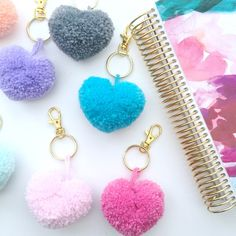 Heart shaped pom pom keychains are back and available in even more colors!  Handmade with lots of love by yours truly :)  Available in silver or gold keychains.
