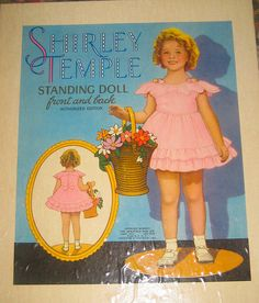 Shirley Temple Standing Doll (front and back)  Saalfield paper doll in box, no. 1727  1935