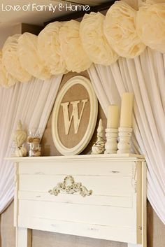 love this head table backdrop, very cozy with the faux mantle. who wants to make it for me? Maybe the monogram alone would look nice on the wall