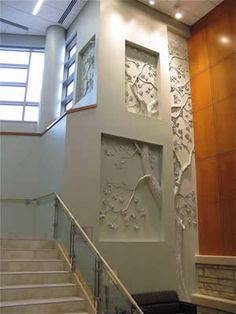 Tom Moberg: TriPoint Medical Center Painesville, Ohio.  Drywall and joint compound.  Moberg uses joint compound and drywall to create elaborate relief sculptures using both additive and subtractive processes.  Support structures are first put in place, joint compound applied, and then the surface is carved.