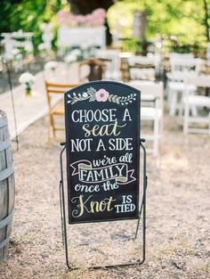 Ceremony sign idea - black sign with modern calligraphy and flower motif {Stephanie Hunter Photography}