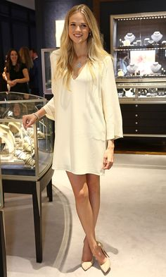 28 June 2016 - Gabrielle Wilde wore a simple white dress with pointed court shoes for the Regent Street flagship store opening of Mappin