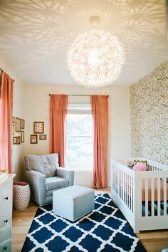 Nursery, baby room, peach drapery, gold wallpaper, blue rug, rose flower print bedroom, ikea, ps maskros pendant ceiling light