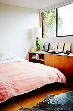 bedroom storage -- Home Tour: A Juicery Exec's Cool Industrial Venice Loft via @domainehome