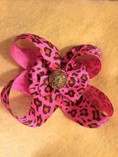 A personal favorite from my Etsy shop https://www.etsy.com/listing/264751220/double-pink-and-black-bow
