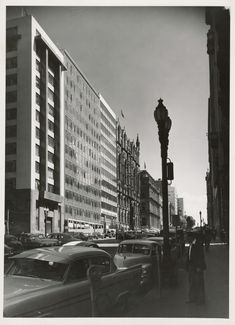 Curtain Wall Central on Queen St #Melbourne, looking Nth to Collins from Flinders La, late 1950s. Of the 2, rightmost is Norwich Union Insurance, Yuncken Freeman, 1957. To its L, Canton Insurance, Bates, Smart & McCutcheon, 1957. Both protected today. In fact everything visible is still with us. SLV. Union Insurance, Melbourne, 1950s, Victoria, Australia, Queen, Architecture, Building, Wall