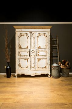 An heirloom white armoire becomes the feature in any bedroom or hall with its impressive detail and grand size.