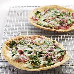 Whole Wheat Pita Pizzas with Spinach, Fontina, and Onions Recipe | MyRecipes.com