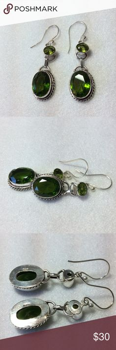 "Peridot 925 Sterling Silver Dangle Earrings These oval peridot stones are going opposite directions for maximum sparkle.   Both are completely surrounded in gleaming Sterling silver.  They measure approx. 2"" long and 5/8"" wide.  Thanks so much! Methigems Jewelry Earrings"