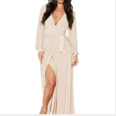 PRICE DROP! Nude Long Sleeved Wrap Dress Maxi wrap dress by Naked Wardrobe. Rayon material, super comfortable, cool, and flattering. Wore to a destination wedding, the fabric combined with a small breeze was a SIGHT TO SEE! Worn once, needs dry cleaning/ press. PRICE FIRM. Naked Wardrobe  Dresses Maxi