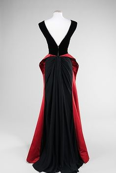 21 Ferocious Gowns Fit For An Evil Queen  To me the bottom half of the dress is backwards.  I would love it turned around. What do you think?