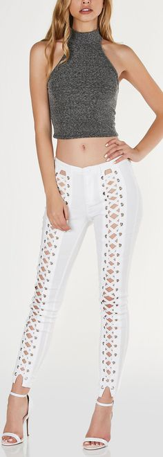 Mid rise skinny fit pants with bold cut out down each leg. Trendy lace up design with button and zip closure. - Rayon-Nylon-Spandex blend - Imported - Model is wearing size S - Runs true to size - Han