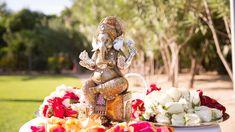 A gilded statue of Ganesh presided over the alfresco Hindu ceremony. #IndianWedding Photography: VIVIDA. Read More: http://www.insideweddings.com/weddings/colorful-destination-indian-wedding-in-playa-del-carmen-mexico/646/