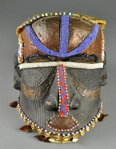 Africa | Bwoom mask from the Kuba kingdom of DR Congo | Wood; glass beads, cowrie shells | 20th century
