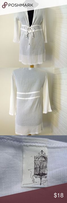 """Anthropologie Birdcage Ivory Tunic Cover Up Anthropologie Birdcage Ivory Tunic Cover Up - size Small  This very beautiful semi-sheer cover up is sexy yet classy.  Two ties in the front.    PLEASE MEASURE FOR SIZE  Measurements: 19.5"""" from shoulder to shoulder 16.5"""" sleeve 20"""" from underarm to underarm 29"""" from the top of the shoulder to the bottom hem Be sure to check out my other listings for super fab vintage and designer items.  I am going to be selling, selling, selling until I get…"""