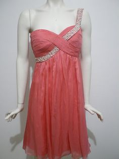 This picture doesn't do this dress justice! A little too creased but gorgeous coral glow dress