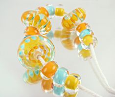 Caribbean Dots Lampwork Bead Set by rapunselstower on Etsy https://www.etsy.com/listing/236966109/caribbean-dots-lampwork-bead-set