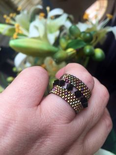 Meticulously handmade ring using black Swarovski Crystals and best quality japanese beads in multifaceted gold hues Unique cut out design which gives the illusion of the. Beaded Jewelry Designs, Seed Bead Jewelry, Bead Jewellery, Heart Jewelry, Jewelery, Diy Beaded Rings, Diy Rings, Beaded Bracelets, Unique Rings