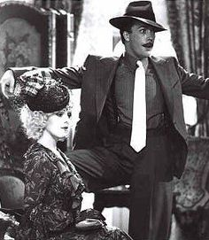 Bernadette Peters and Tim Curry as Lily St. Regis and Rooster - Annie