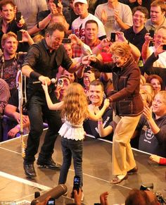 Tunnel vision of love: Bruce Springsteen kept his eyes on his mother and niece as they Danced in the Dark in New York