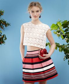 SuiteBlanco Lace top, striped skirt and heart shaped hand bag.