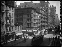 Broadway Series. View of west side of Bway looking north from Bleecker Street. Ligget's Drugstore on the near corner at left. On the far corner is No. 463, with I. Moss' Hats sign on 2nd floor. Date: May 27, 1920